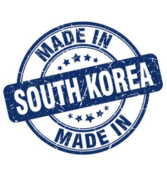 made in south korea blue grunge round stamp vector image vector image