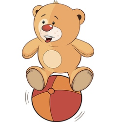 A stuffed toy bear cub and a ball vector