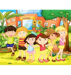 Boys and girls having fun in the school yard vector image vector image