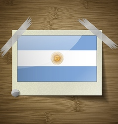 Flags of argentina at frame on wooden texture vector