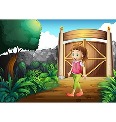 A young girl at the gated yard vector