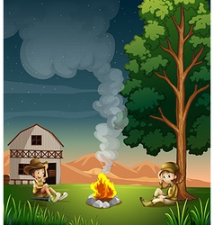 Two explorers making a campfire vector image vector image