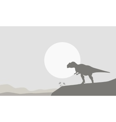 Silhouette of mapusaurus on the cliff vector image vector image