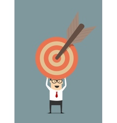 Businessman holding target with arrow vector