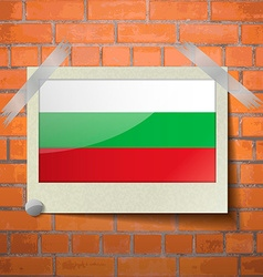 Flags bulgaria scotch taped to a red brick wall vector