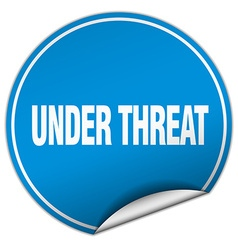 Under threat round blue sticker isolated on white vector