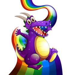 A playful violet dragon and a rainbow vector image vector image