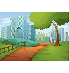 A pathway going to the tall buildings vector