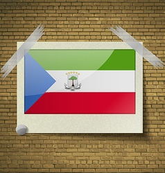 Flags equatorial guinea at frame on a brick vector