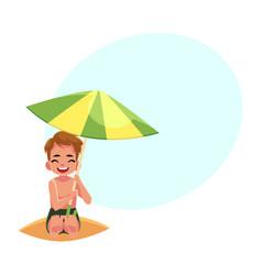 Happy little boy hiding from sun under big beach vector