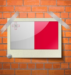 Flags malta scotch taped to a red brick wall vector