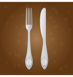 Fork and table knife on a brown background vector image