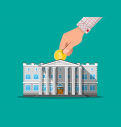hand putting coin into bank building vector image