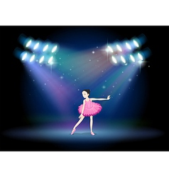 A young girl dancing ballet with spotlights vector