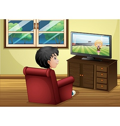 A young boy watching TV at the living room vector image