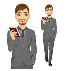 Handsome business man holding notebook vector