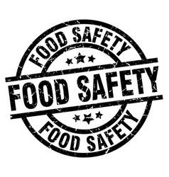 Food safety round grunge black stamp vector