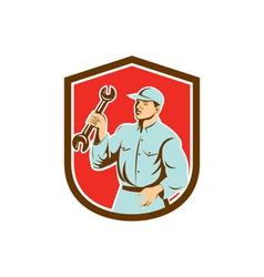 Mechanic holding spanner wrench shield retro vector