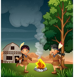 Two little indians with a campfire vector