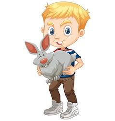 Boy hugging a gray bunny vector image