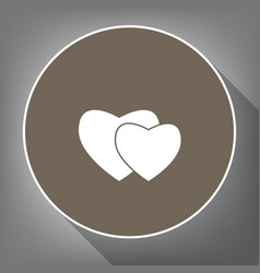 Two hearts sign white icon on brown vector