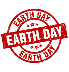 earth day round red grunge stamp vector image vector image