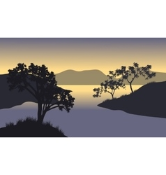 Silhouette of hills and tree at the morning vector image