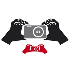 Camera in hands icon vector