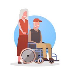senior man on wheel chair and woman couple vector image