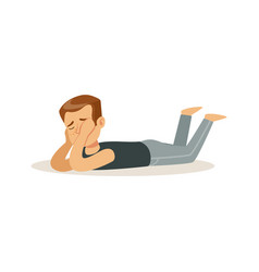 frustrated boy character lying on his stomach on vector image