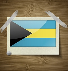 Flags bahamas at frame on wooden texture vector
