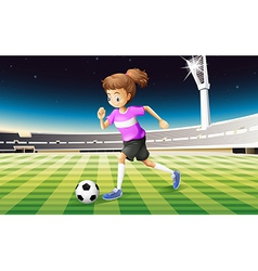 A girl at the field playing football vector