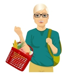 young man holding a full shopping basket vector image