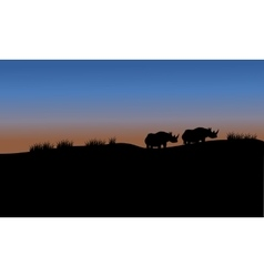 Rhino in fields scenery silhouette vector