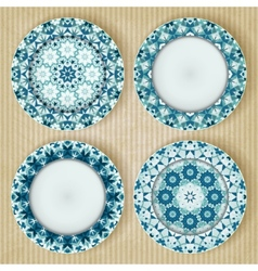 Plates with kaleidoscope pattern set vector