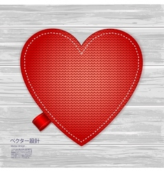 Valentines kniited heart on a wood background vector