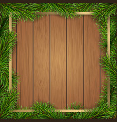 pine tree branches frame on wooden background vector image vector image