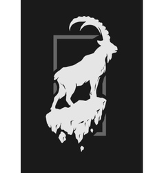 Silhouette of a mountain goat standing on a rock vector