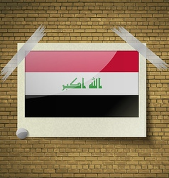 Flags iraq at frame on a brick background vector
