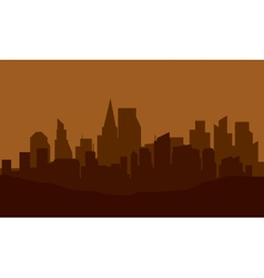 Silhouette of city on the hills vector