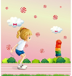 A girl playing at the field with candy balls vector image vector image