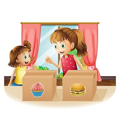 A woman and a young girl near the two boxes vector