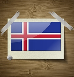 Flags iceland at frame on wooden texture vector