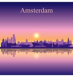 Amsterdam silhouette on sunset background vector