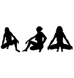 Silhouettes of women crouching poses vector