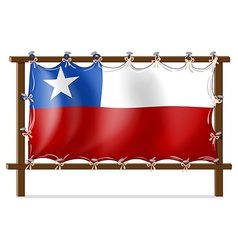 A wooden frame with the flag of chile vector