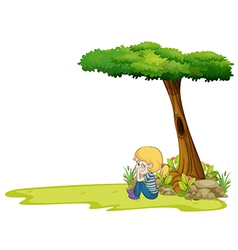 A girl sitting under the big tree vector image