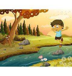 A boy playing at the flowing water vector image