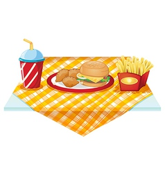 A fastfood table with foods vector