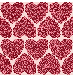 Seamless background with floral hearts vector